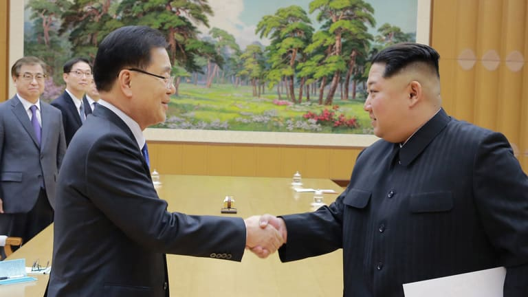 North Korean leader Kim Jong-un shakes hands with South Korean National Security Director Chung Eui-yong after Chung gave Kim a letter from South Korean President Moon Jae-in.