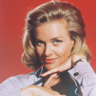Honor Blackman, posing in publicity photograph for the film 'Goldfinger', circa 1964.