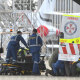 A survivor of the volcano eruption being removed on a stretcher from a RAAF Hercules at Sydney Airport on Thursday.