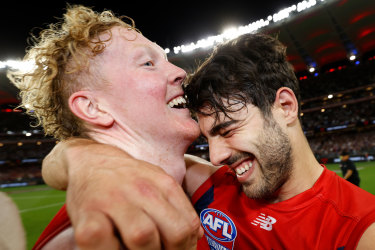 Midfield bulls Christian Petracca (right) and Clayton Oliver embrace.