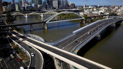 Man on scooter dies after crashing into pole near Brisbane bridge