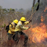 Members of the the National Center to Prevent and Combat Forest Fires fight a fire in the Xingu Indigenous Park in Mato Grosso in Brazil.