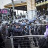 Six police officers hospitalised, more than 200 arrested in Melbourne anti-lockdown protests