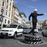 Return of Rome's traffic police to landmark piazza brings unlikely joy