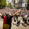 Protest and celebration: Thousands gather for Australia Day events
