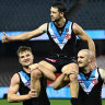 MELBOURNE, AUSTRALIA - JULY 23: Travis Boak of the Power is chaired off by Ollie Wines and Sam Powell-Pepper of the Power in his 300th game during the round 19 AFL match between Port Adelaide Power and Collingwood Magpies at Marvel Stadium on July 23, 2021 in Melbourne, Australia. (Photo by Quinn Rooney/Getty Images)