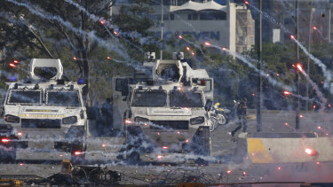 Fire crackers launched by opponents to Venezuela's President Nicolas Maduro land near Bolivarian National Guard armored vehicles during an attempted military uprising in Caracas on Tuesday.
