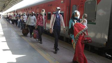 Migrant workers in India board a train in Gujarat.