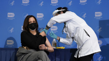 US Vice-President Kamala Harris as she received her second COVID jab early this year. The higher rate of vaccinations will protect America from large-scale economic damage in a Delta variant surge, Goldman Sachs says.