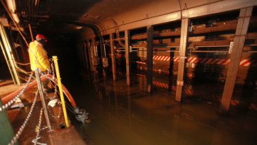 A growing problem for subway stations. Floodwaters from Hurricane Sandy below Grand Central Station in New York in 2012.