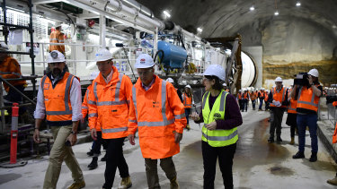 Transport Minister Andrew Constance, third from left, and Premier Gladys Berejiklian inspect the boring machine at Barangaroo.