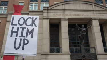 "A demonstrator holds a ""Lock Him Up"" sign before the trial of former Trump Campaign Manger Paul Manafort outside of District Court in Alexandria, Virginia, US."