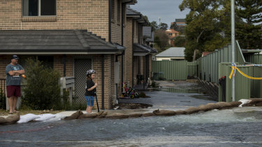 Emergency services are trying to isolate the water flow, after up to 60 houses were affected.