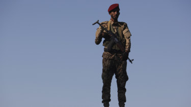 A soldier allied to Yemen's internationally recognised government stands guard at the port of Aden.