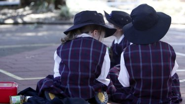 The federal government has threatened to withhold funding for schools if states don't sign up to its new education funding deal