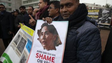 Demonstrators gather outside the International Court of Justice in The Hague on Tuesday.