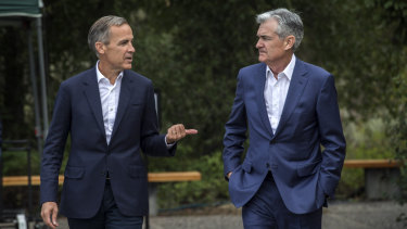 Bank of England Governor Mark Carney, left, chatting with Fed chairman Jerome Powell at the Jackson Hole Economic Policy Symposium.
