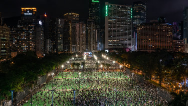 Thousands of participants take part in a memorial vigil in Victoria Park in Hong Kong, China.