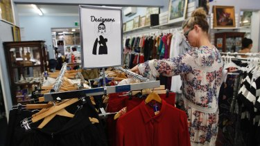 Bargain hunters search the racks inside the Vinnies store  in Waverley.