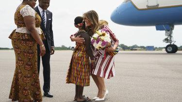 Melania Trump embraces flower girl Lillian Naa Adai Sai, 8, at Kotoka International Airport in Accra, Ghana.