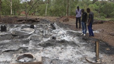 Attacks by extremists are not uncommon in Mali. In this picture from June 2017, locals survey the burned Campement Kangaba after an Islamic extremist attack near Bamako.