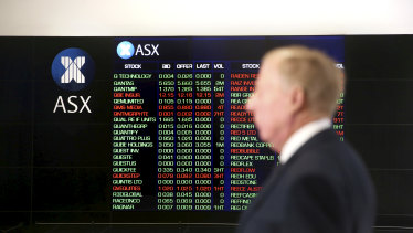 ASX stock figures light up on electronic displays at the ASX foyer in the Sydney CBD.