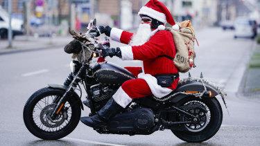 "Patrick Kuntz, founder of the ""Harley-Davidson riding Santas"" initiative, rides through the centre of Landau, Germany."