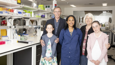 Cancer researcher Professor Sudha Rao (centre) at the Melanie Swan Memorial Translational Centre with Melanie's parents David and Carol Swan, and daughters Sophie (8) and Emma (11) Chamberlain.