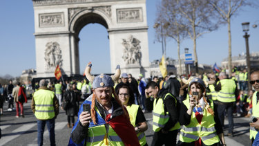 Yellow vest protesters gather at the Arc de Triomphe in Paris, France, on Saturday for the 15th weekend of protest.