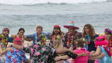 Prince Harry and Meghan, Duchess of Sussex sit on the sand with 'Anti-bad-vibe circle' local surfing community group, known as OneWave, raising awareness for mental health and wellbeing in a fun and engaging way at Bondi Beach.