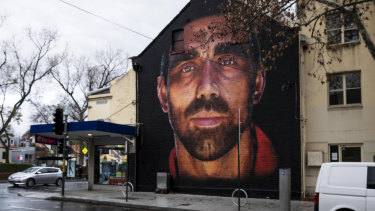 The  mural of former AFL Sydney Swans player Adam Goodes painted by Apparition Media on the corner Foveaux and Crown street in Surry Hills this week.