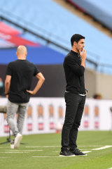 Mikel Arteta watches on as his side beats City.