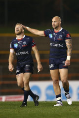 Andrew Deegan of the Rebels and Bill Meakes of the Rebels celebrate victory during the round 6 Super Rugby AU match between the Rebels and Brumbies at Leichhardt Oval on August 07, 2020 in Sydney, Australia.