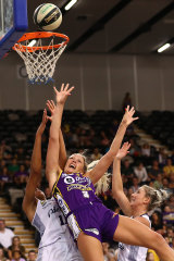 Off balance: Sophie Cunningham gets knocked off course on her way to a lay-up for the Boomers.