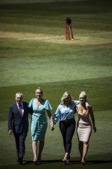 Allan Border, Phoebe Jones, Jane Jones and Augusta Jones with Deano's bat and baggy green at the wicket.