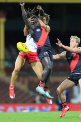 Anthony McDonald-Tipungwuti and the Swans' Josh Kennedy contest the ball.