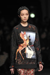 A model walks the runway at the Givenchy Autumn Winter 2013 fashion show during Paris Fashion Week.