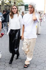 Baggy not daggy ... stylist Olivia Palermo (left) and fashion editor Sarah Harris at New York Fashion Week.