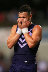 Ryan Crowley of the Dockers looks on dejected after losing the semi final.