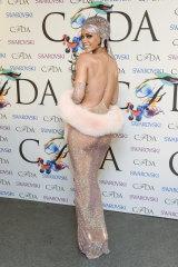 Fashion Icon Award honoree Rihanna with her award at the 2014 CFDA Fashion Awards.