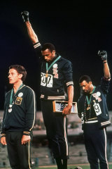 Peter Norman, left, stands next to Tommie Smith and John Carlos in Mexico.