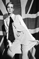 Twiggy models a Mary Quant waistcoat and shirt ensemble in 1966.