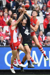 Callum Sinclair of the Swans spoils a mark by Jack Silvagni of the Blues.