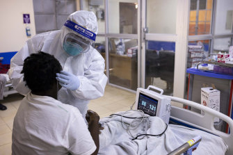 A nurse checks a COVID patient in the intensive care unit in Machakos, Kenya.