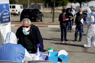 An Israeli man fills in his ballot paper at a special polling station.