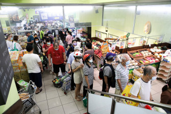 Taipei has urged people not to panic shop as an outbreak shatters Taiwan's record on fighting the coronavirus.