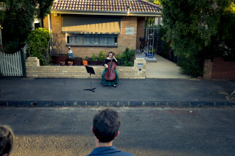"""Taking it to the streets … chamber musician Josephine Vains plays a social distancing """"concert"""" for her neighbourhood in Melbourne's Brunswick."""