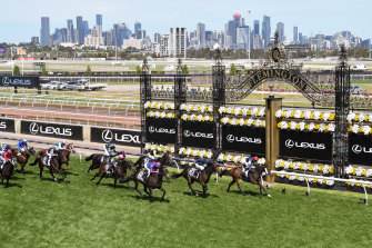 Irish thoroughbred Twilight Payment, ridden by Jye McNeil, wins the Melbourne Cup in 2020.