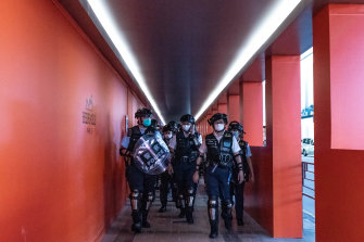Hong Kong riot police patrol during a demonstration outside a shopping mall on May 10.