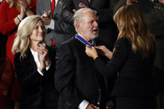 Rush Limbaugh, centre, receives the Medal of Freedom from then-first lady Melania Trump during Donald Trump's 2020 State of the Union address.